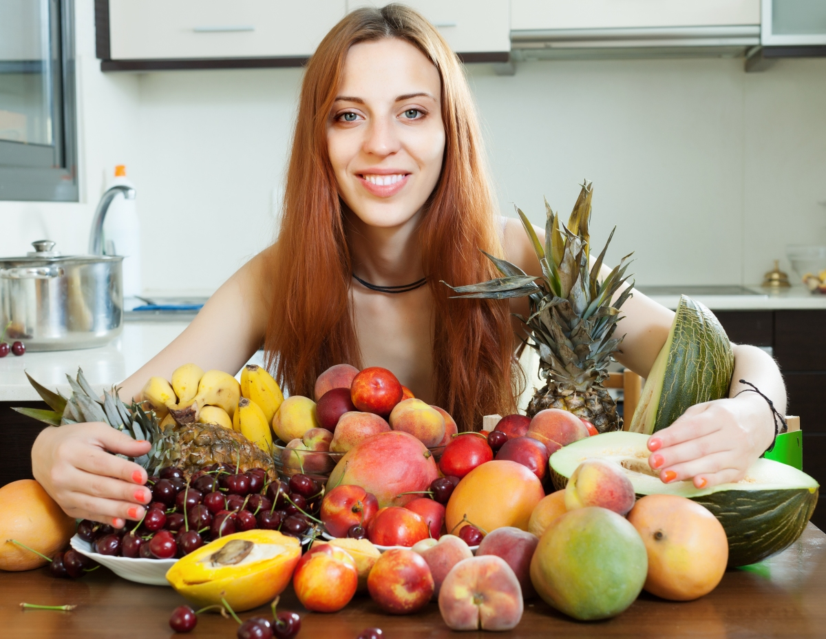 Happy long-haired girl with fruits